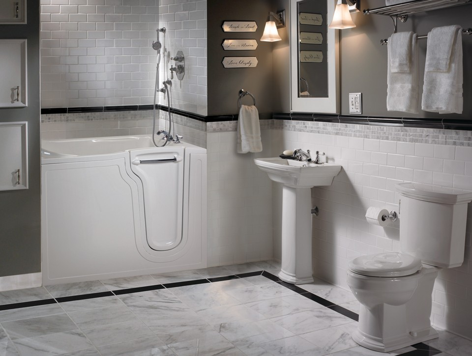 A walk-in tub, pedestal sink, and raised-height toilet are key bathroom safety features.