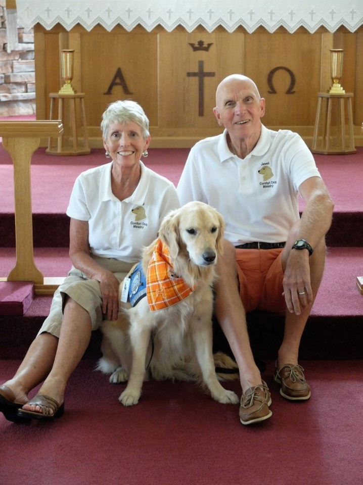 Comfort dog Jewel with caregivers and handlers Judy and Steve Schoenherr at Christ Our Savior Lutheran Church in Loudon. A team of six church families care for Jewel and take her on visits to offer calm canine comfort to people. Photo by Amy McRary/News Sentinel