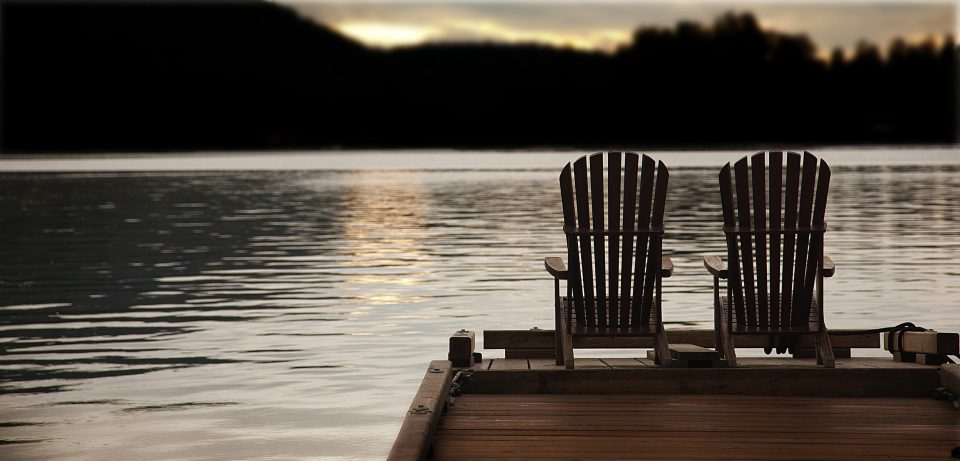 Adirondack chairs on a pier
